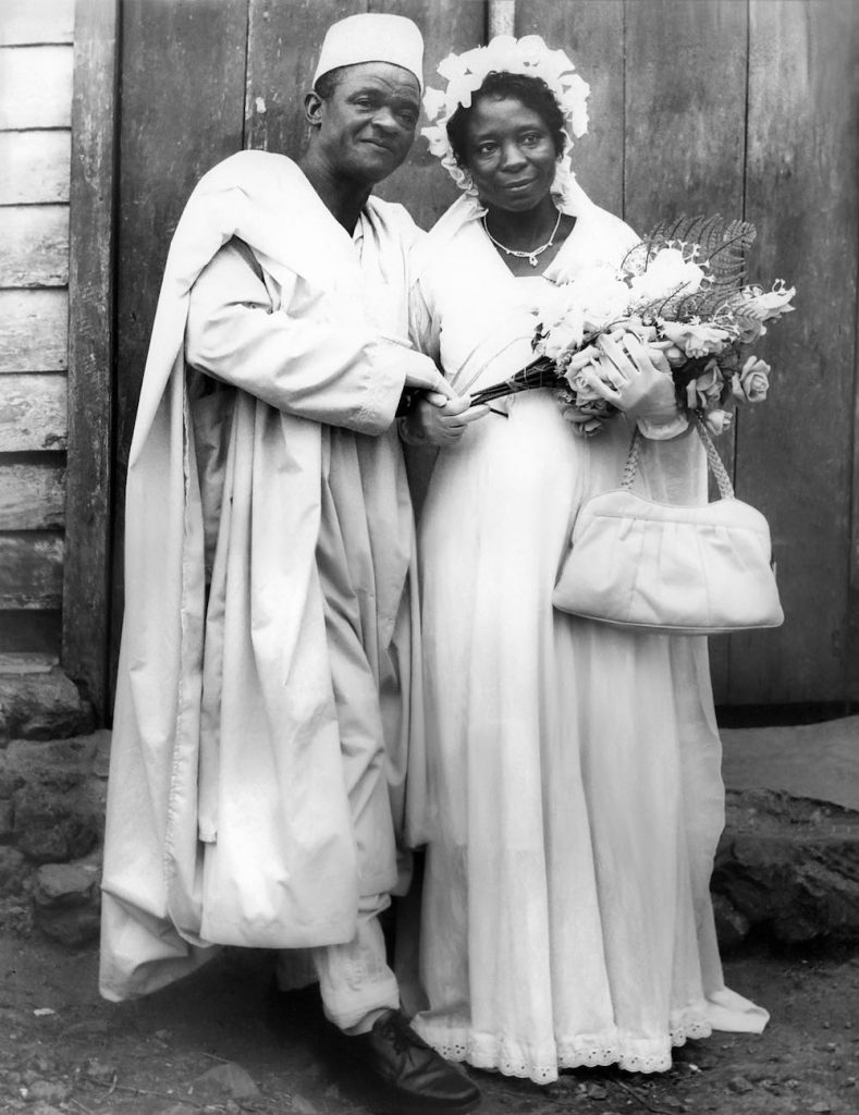 Chapter2 My parents on their Christian wedding day in front of our local church in Munyenge