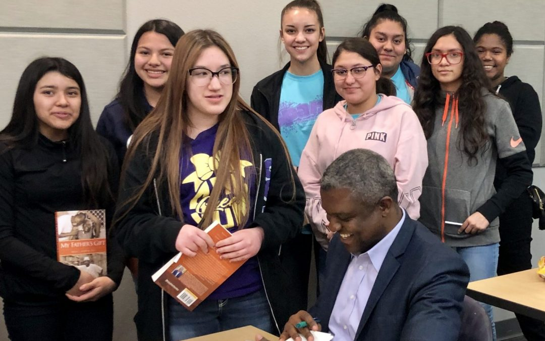 Sixtus Atabong speaks with the Junior League of Lubbock SPARK students